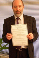 Mike Kennedy, Technical Director, Chiron with certificate
