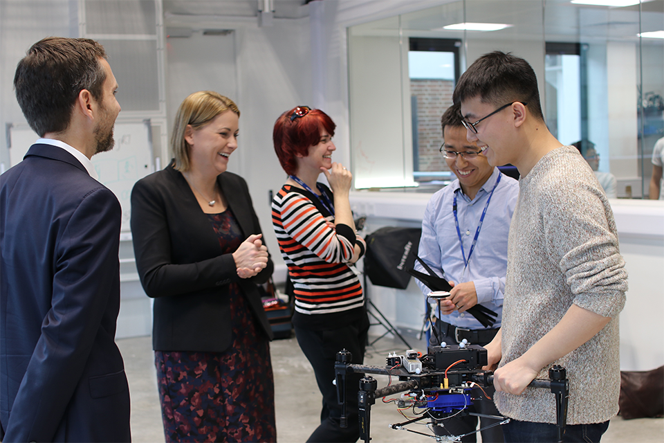 Aviation Minister, Baroness Sugg meets PhD students working on drone technology at the Aerial Robotics Lab at Imperial College, London.