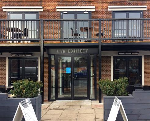 Transom door closers and handles ensure security and aesthetics at London theme pub