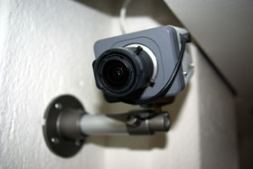 A PoE enabled IP security camera is an example of a powered device (PD) equipped to accept low voltage power transmitted over Ethernet cabling.
